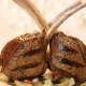 grilled rib chop with savory artichoke tapenade