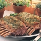 herb-crusted racks of American lamb on serving platter
