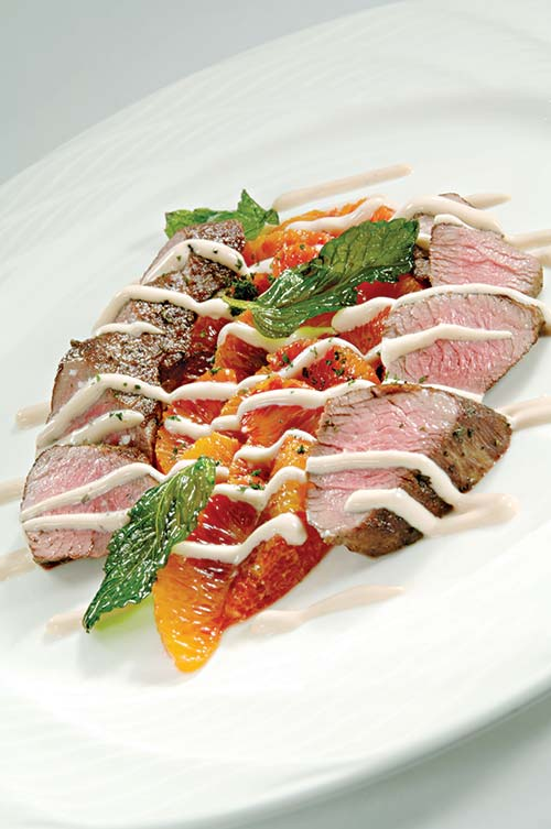 Marinated american lamb tenderloin and blood orange salad